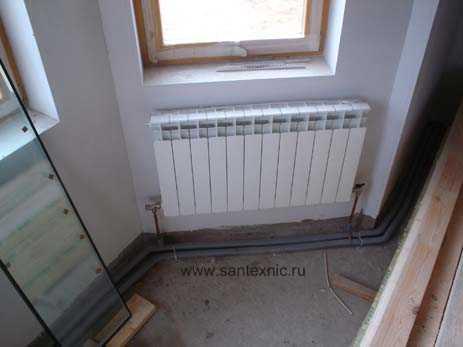 Сантехнические работы.  Монтаж алюминиевого секционного радиатора по напорной схеме.  Обвязка по меди.